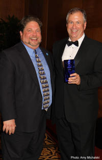 AIIMNE President Steve Weissman Accepting AIIM Award from AIIM President John Mancini on Behalf of Gene Pawlowski